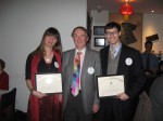 President Peter Mosse presenting membership certificates to Laura and Keir Daniels