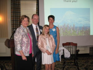 Newly elected President Ellen Parke with guest speaker Kip Knudson, his wife Paula Conru and daughter McKinley Conru-Knudson