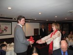 Program Chair Sue Murphy presenting C. Scholar Kevin Short with a gift for being born in the year of the Green Sheep