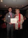 C. Sue Murphy presenting a membership certificate to Brad Vogel