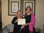 President Ellen Parke presented new member Susan Reickert with her certificate.