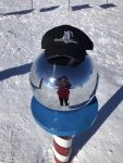 Circumnavigator Suzanne Frye, New York Metro, took her Club cap to the South Pole