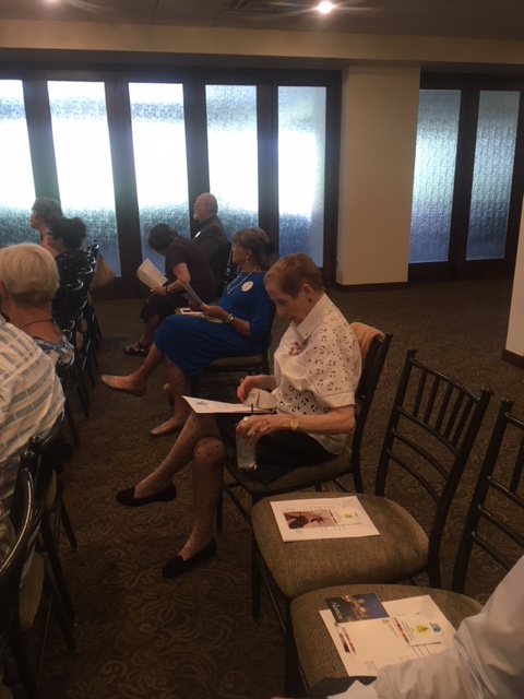 C. Kaye Jenista studying the Desert Chapter April meeting agenda at the Arizona Country Club