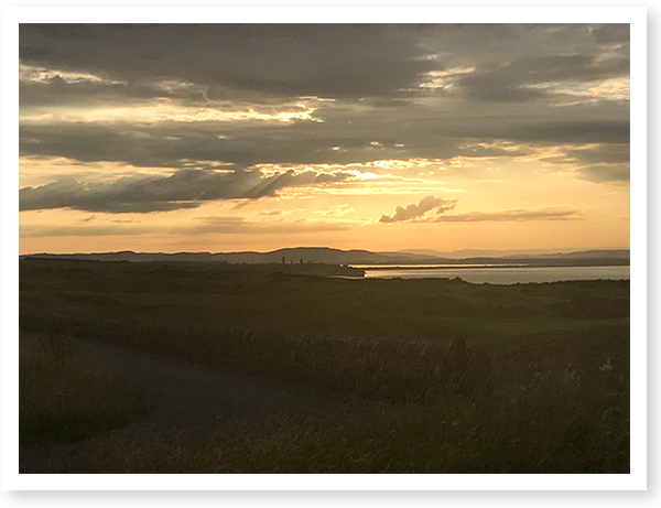 Sunset over Saint Andrew's, Scotland. Cs. David and Dottie Mink enjoyed The Open golf tournament at Carnoustie.