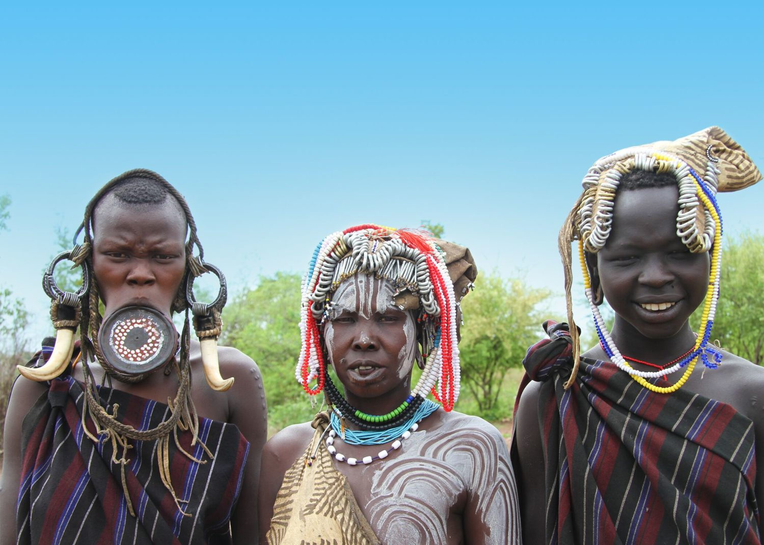 This image has an empty alt attribute; its file name is Bassett-Mursi-Tribal-Women-South-Omo-Region-Ethiopia--1500x1071.jpeg
