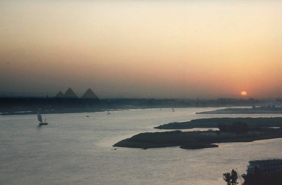 This image has an empty alt attribute; its file name is Restarick-Sunset-on-the-Nile-and-the-Pyramids-3.jpg