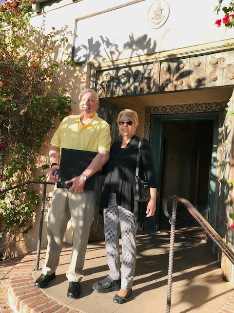 John Weed and wife Cynthia arrive at Desert Chapter Happy Hour get together at Royal Palms Resort with photos in hand of their summertime hiking trip to England