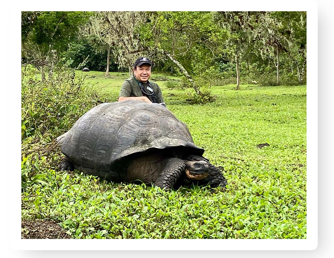 Mo posed with a giant tortoise